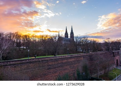 Prague, Czech republic: Panorama of Vysehrad basilica during the sunset. Orange clouds above the ancient church in czech capital.