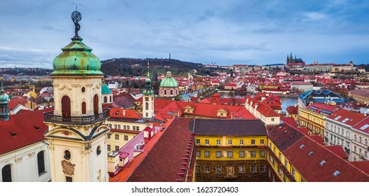 Prague, Czech Republic - Panoramic view of Prague with the tower of the baroque library (Klementinum), the famous Charles Bridge, St. Francis Of Assisi Church and St. Vitus Cathedral at background