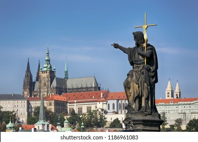 Prague, Czech Republic, sculpture on the Charles Bridge against the background of the blue sky and Prague Castle