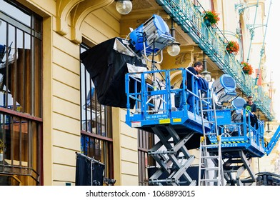 PRAGUE, CZECH REPUBLIC - SEPTEMBER, 13, 2014: The lights on the rig with extra lights and softboxes. Shooting a movie or TV series. Lighting equipment outside the house where the shooting takes place.
