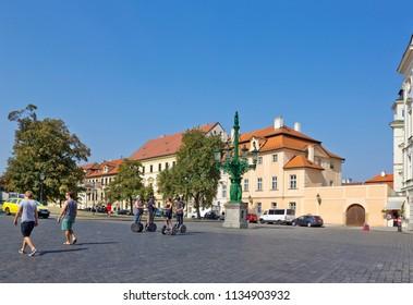 Prague, Czech Republic - September 13, 2016: Hradcanske namesti Square in the Castle District with baroque street gas lamp