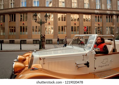 Prague, Czech Republic, September 15, 2017: old vitage touristic retro car on the street in Prague used for tourist excursions at the center of old Prague, Czech Republic.