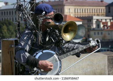 Prague, Czech Republic, September 17, 2018. A street musician plays musical instruments