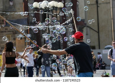 Prague, Czech Republic, September 17, 2018. A man makes soap bubbles in the Prague street