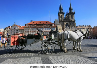Prague, Czech Republic, September 18, 2018. Horse-drawn carriage and coachman waiting for tourists in the square in the center of Prague