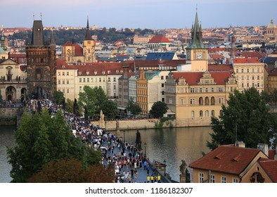 Prague, Czech Republic, September 19, 2018. Beautiful view from above on the city, red roofs of houses, the Vltava River and Charles Bridge