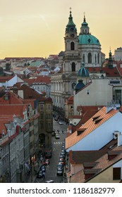 Prague, Czech Republic, September 19, 2018. Beautiful evening view from above on the city, the red roofs of houses in Mala Strana and the church of St. Nicholas