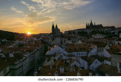 Prague, Czech Republic, September 19, 2018. Beautiful view from above on the city, red roofs of houses, Prague Castle and church in Mala Strana at sunset