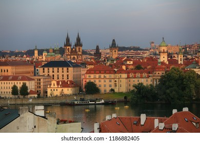 Prague, Czech Republic, September 19, 2018. Beautiful view from above on the city, red roofs of houses, the Vltava River and the Temple in the evening light
