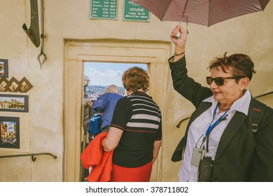 PRAGUE, CZECH REPUBLIC - SEPTEMBER 19, 2015: Tourists in Prague on September 19, Prague, Czech Republic. Annually Prague is visited by more than 3,5 million tourists.