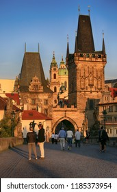 Prague, Czech Republic, September 20, 2018. Tourists on the Charles Bridge in the early morning
