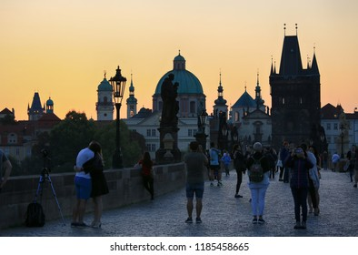 Prague, Czech Republic, September 20, 2018. Tourists and photographers on the Charles Bridge in the early morning in anticipation of sunrise