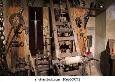 Prague, Czech Republic - September 23, 2017: Medieval Torture Equipment in museum. Rack, break-knee, masks