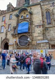 Prague, Czech Republic - September 23, 2018: Old Town Astronomical Clock in repair works, Prague, Czech Republic. Tourists enjoying the city.