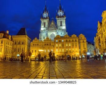 Prague, Czech Republic - September 23, 2018: Church of our Lady before Tyn, Old Town Square, Prague, Czech Republic. Tourists enjoying the city at night.