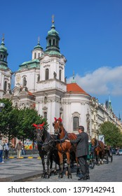 PRAGUE, CZECH REPUBLIC - SEPTEMBER 23, 2008: Coachman and his horse-driving carriage at city center of Prague