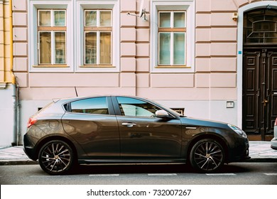 Prague, Czech Republic - September 23, 2017: Side View Of Alfa Romeo Giulietta 940 Car Of Black Metallic Color Parked In Street.