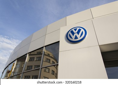 PRAGUE, CZECH REPUBLIC - SEPTEMBER 24: Volkswagen car maker logo on a building of dealership on September 24, 2015 in Prague, Czech republic.