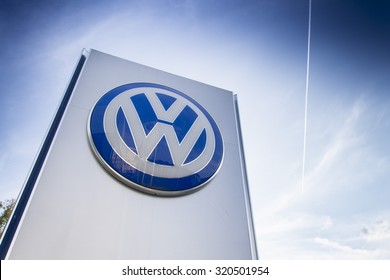PRAGUE, CZECH REPUBLIC - SEPTEMBER 24: Volkswagen car maker logo on a building of dealership on September 24, 2015 in Prague, Czech republic. Great emission scandal raises around number of VW cars.