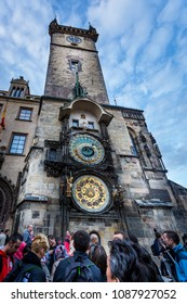 PRAGUE, CZECH REPUBLIC - SEPTEMBER 25, 2014: Ground view of a group of people outside the astronomical clock tower in Prague September 25, 2014.