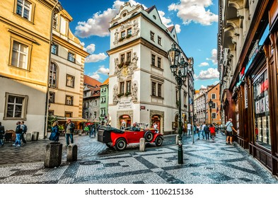 Prague, Czech Republic - September 25 2016: Tourists pass by shops and cafes in a picturesque section of Old Town Prague, Czech Republic.