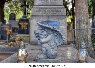 Prague, Czech Republic - September 25, 2018: Mausoleum at Vysehrad Cemetery Prague. Figure of a sleeping angel