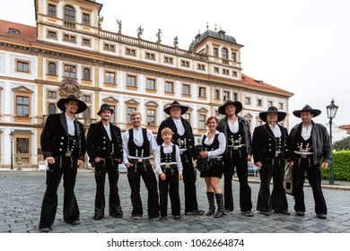PRAGUE, CZECH REPUBLIC - SEPTEMBER 26, 2014: Portrait of a group of german male and female journeymen carpenters in traditional clothings outdoors, Prague September 26, 2014.