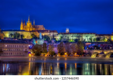 PRAGUE, CZECH REPUBLIC - SEPTEMBER 26, 2014: Beautiful long exposure night view by the water with Prague Castle and surrounding buildings illuminated  in Prague Czech Republic September 26, 2014.