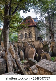 Prague, Czech Republic - September 26, 2018: Tombstones on Old Jewish Cemetery in the Jewish Quarter in Prague. One of the most important Jewish monument.