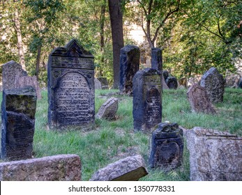 Prague, Czech Republic - September 26, 2018: Tombstones on Old Jewish Cemetery in the Jewish Quarter in Prague.There are about 12000 tombstones. One of the most important Jewish monument.