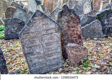 Prague, Czech Republic - September 26, 2018: Tombstones on Old Jewish Cemetery in the Jewish Quarter in Prague.There are about 12000 tombstones presently visible.