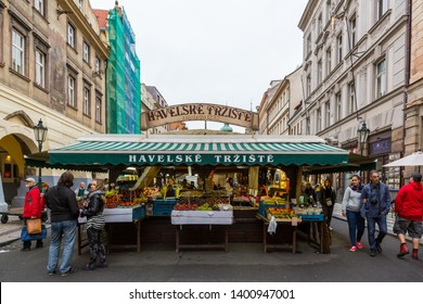 PRAGUE, CZECH REPUBLIC - SEPTEMBER 26, 2014: Outdoor front view of people shopping at a street market stand in Prague Czech Republic September 26, 2014.