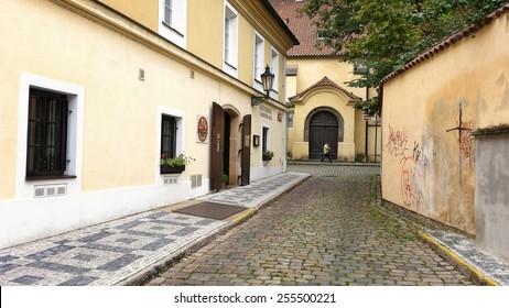Prague, Czech Republic - September 26, 2014: Small street Anezska in Old Town (Stare Mesto). In the left side is seen the entrance to the restaurant U Cerveneho kola.