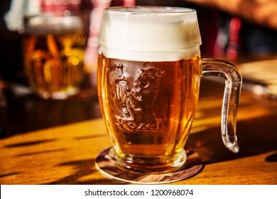 Prague, Czech Republic, September 27, 2018: Glass of unfiltered Czech beer Kozel