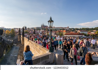 PRAGUE, CZECH REPUBLIC - SEPTEMBER 27, 2014: High angle view of a crowd of people walking on the famous Charles bridge with Prague Castle in the background.  Prague Czech Republic September 27, 2014.