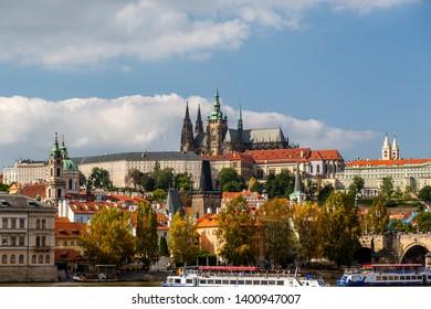 PRAGUE, CZECH REPUBLIC - SEPTEMBER 27, 2014: Cityscape view of Prague Castle and surrounding buildings and boats in Prague Czech Republic September 27, 2014.