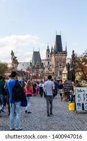 PRAGUE, CZECH REPUBLIC - SEPTEMBER 27, 2014: Street view of people walking on a cobblestone street with street vendors near Prague Castle in Prague Czech Republic September 27, 2014.