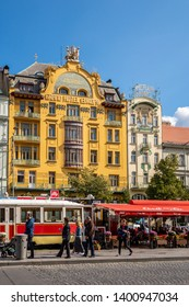 PRAGUE, CZECH REPUBLIC - SEPTEMBER 27, 2014: Front view of the famous yellow Grand Hotel Europa with people and a coffee shop in the foreground in Prague Czech Republic September 27, 2014.
