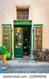 PRAGUE, CZECH REPUBLIC - SEPTEMBER 28, 2014: Front street view of a green decorative liquor store selling absinthe beverage in the old town of Prague Czech Republic September 28, 2014.
