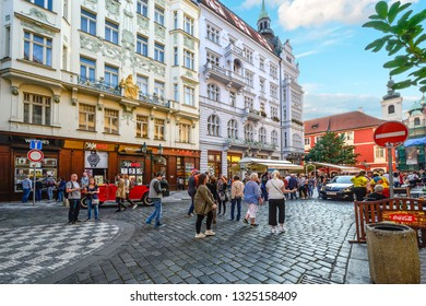Prague, Czech Republic - September 28 2018: A busy street in Old Town Prague with tourists and locals window shopping and enjoying the medieval center of the city.