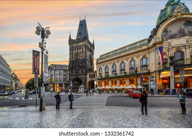 Prague, Czech Republic - September 28 2018: The Powder Tower separating Old Town from New Town alongside the Municipal House as the sun goes down in Prague, Czech Republic