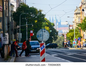 Prague, Czech Republic - September 28, 2017: Francouzska street and beautiful view on city center and St. Vitus cathedral. Urban traffic in Prague