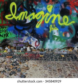 PRAGUE, CZECH REPUBLIC - SEPTEMBER 30: The Lennon Wall since the 1980s is filled with John Lennon-inspired graffiti and pieces of lyrics from Beatles songs on Sep 30, 2014 in Prague, Czech Republic