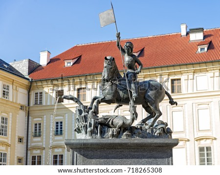 PRAGUE, CZECH REPUBLIC - SEPTEMBER 5, 2017: Copy of a Gothic bronze statue of Saint George who kills a dragon, located in the third courtyard of the Prague Castle.