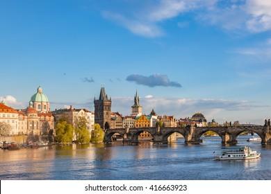 Prague, Czech Republic skyline with historic Charles Bridge and Vltava river on sunny day.