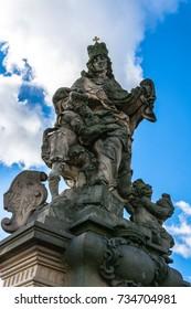 Prague, Czech Republic: Statue of Saint Ludmila an outdoor sculpture on the south side of Charles Bridge over the river Vltava.