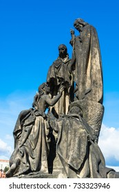 Prague, Czech Republic: Statues of Saints Cyril and Methodius on the north side of Charles Bridge over the river Vltava.