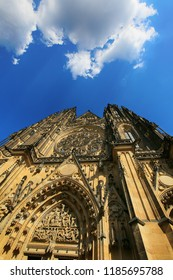 Prague, Czech Republic, view of the Gothic Catholic Cathedral of St. Vitus in Prague Castle and white clouds in the blue sky