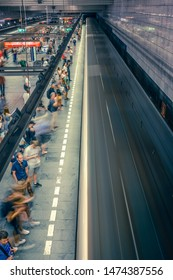 Prague, Czech Republic,23 July 2019; People at metro station entering subway train or walking by, long exposure technique for movement. Urban scene, city life, public transport and traffic concept.