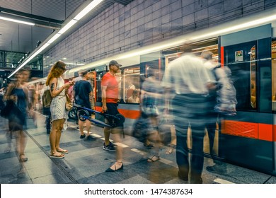 Prague, Czech Republic,23 July 2019; People at metro station entering subway train, long exposure technique for movement. Urban scene, city life, public transport and traffic concept.
